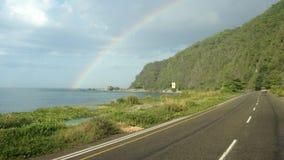 Regenbogen zwischen Nieselregen Stockfotografie