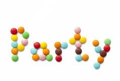 Regenbogenparty mit mehrfarbiger Schokoladensüßigkeit Lizenzfreie Stockbilder