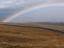 Regenboog en stormachtige wolken Royalty-vrije Stock Foto