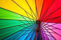Regenboog multicolored achtergrond van een paraplu Stock Foto