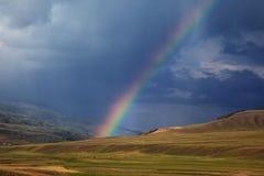 Regenboog na onweer Stock Foto
