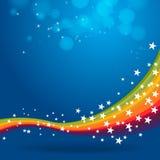Regenboog op blauwe achtergrond Royalty-vrije Stock Foto's