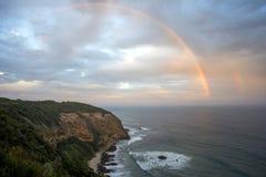 Regenboog over baai royalty-vrije stock foto