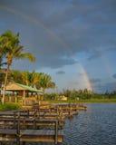 Regenboog over de dokken Stock Foto