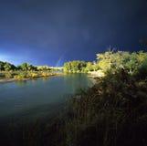 Regenboog over rivier Irtysh. Royalty-vrije Stock Afbeeldingen