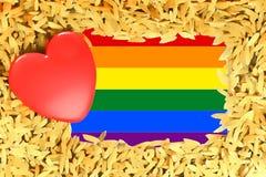 Regenboog Rood hart en de vrolijke de trotsvlag van LGBT Stock Afbeeldingen