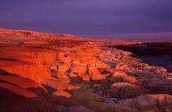 Regenboogondiepte bij zonsondergang stock afbeeldingen