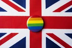 Regenboogvlag en vlag van het Verenigd Koninkrijk royalty-vrije stock fotografie