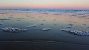 Regenboogzonsondergang en oceaan Royalty-vrije Stock Foto's