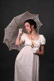 Regency. Female model in historical regency period dress holding an open parasol Royalty Free Stock Images