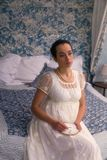 Regency woman with embroidery stock photography