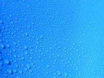 Regendruppel op blauw Royalty-vrije Stock Afbeelding