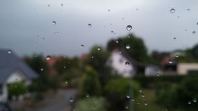 Regendruppels bij Venster Royalty-vrije Stock Foto