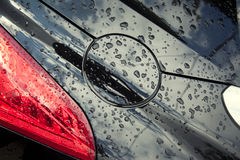 Regendruppels op de auto Stock Foto