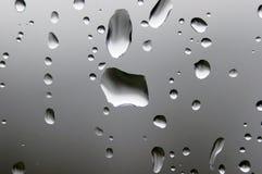 Regendruppels op Glas Royalty-vrije Stock Afbeeldingen