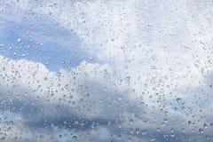 Regendruppels op het glas Stock Foto