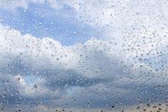 Regendruppels op het glas Stock Afbeelding