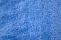 Regendruppels op tarp Stock Afbeelding