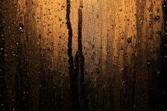 Regendruppels in vensterglas Stock Afbeelding