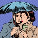 Regenman en vrouw onder romantische paraplu Royalty-vrije Stock Foto