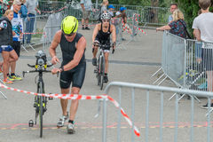 Regensburg, Bavaria, Germany, August 06, 2017, 28th Regensburg Triathlon 2017, Downswing of a bike racer in the transition area Royalty Free Stock Photos