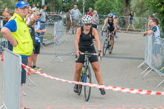 Regensburg, Bavaria, Germany, August 06, 2017, 28th Regensburg Triathlon 2017, Downswing of a bike racer in the transition area Stock Image