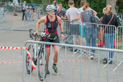 Regensburg, Bavaria, Germany, August 06, 2017, 28th Regensburg Triathlon 2017, Downswing of a bike racer in the transition area Stock Photography