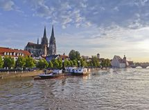 Regensburg with cathedral at the Danube in Germany. View of the medieval city of Regensburg on the Danube with a museum ship on the river Danube in the stock photo