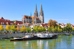 Regensburg Cathedral and old steamship at the shore of Danube Stock Images