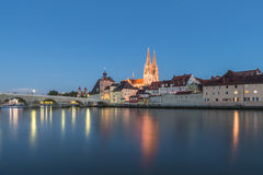 Regensburg in the evening with view to the Cathedral and stone bridge, Germany Royalty Free Stock Images