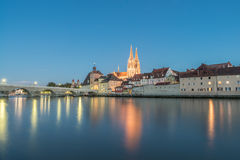 Regensburg in the evening with view to the Cathedral and stone bridge, Germany Stock Image