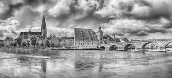 Regensburg (Germany). Black&White panorama of Regensburg downtown with its old cathedral and the stone bridge (Germany Royalty Free Stock Image