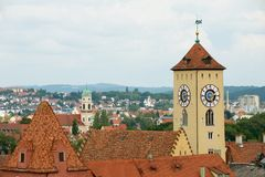 Historical town hall clock tower with the panorama of the old city in Regensburg, Germany. royalty free stock photo