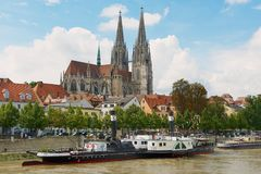 View to Regensburg cathedral and historical buildings with Danube river at the foreground in Regensburg, Germany. REGENSBURG, GERMANY - SEPTEMBER 03, 2010: View Stock Photography