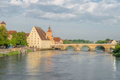 Regensburg in the morning light on a summer day with the promenade the Cathedral and the stone bridge Royalty Free Stock Photography