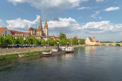 Regensburg in the morning light on a summer day with the promenade the Cathedral and the stone bridge Royalty Free Stock Photos