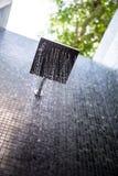 Regenschauer im Freien Stockbild