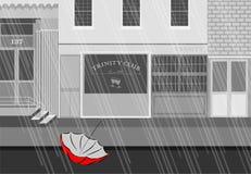 Regenschirm ausgelassen in die srteets stockbilder