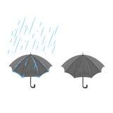 Regenschirm und Regen Lizenzfreie Stockfotos