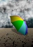 Regenschirm und Wüste Lizenzfreie Stockfotografie