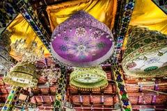 Regenschirme über den Abdrücken Stockbilder
