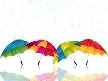 Regenschirme, die vor dem Regen sich schützen Lizenzfreie Stockfotos