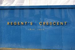 Regent`s Crescent construction hoarding board, London. UK. Development by Great Marlborough Estates Grade I listed building, designed by John Nash royalty free stock photos
