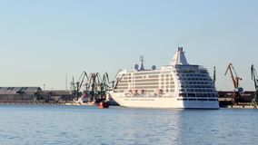Regent Seven Seas Voyager leaving the cruise terminal of Klaipeda city stock video