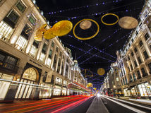 Regent Street Christmas Lights em Londres Fotografia de Stock Royalty Free
