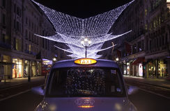 Regent Street Lights and London Taxi Royalty Free Stock Photos