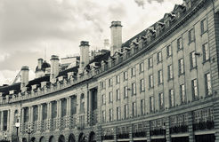 Regent Street, London. The characteristic curve of buildings on Regent Street in central London, UK. Retro toned Royalty Free Stock Photography