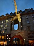 Regent Street with Christmas lights crowded with people. London, United Kingdom. royalty free stock photos