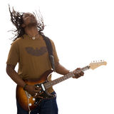 Reggae. African adult male with dreadlocks flying jamming on a guitar on a white background Stock Images