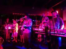 Reggae band Guidance Band jams at the Anna O'Briens. HONOLULU, HI - FEBRUARY 21, 2015: Reggae band Guidance Band jams at the Anna O'Briens in Honolulu, Hawaii Stock Image